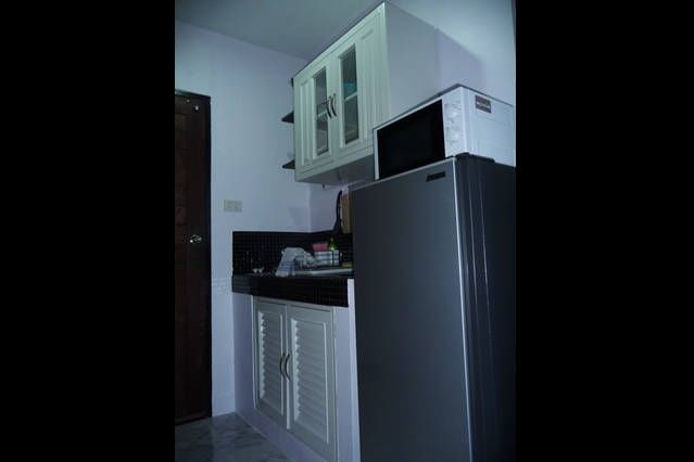 studio  kitchenette with kettle, toaster, coffee maker, microwave and dishwasher full.